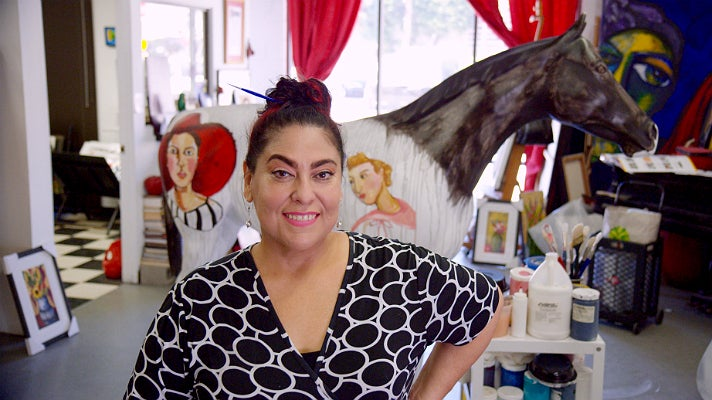"Yolanda González in her studio with ""Beauty at the Races"""
