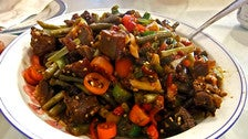 Smoked duck stir fried with Hunan pickled green beans and chilies at Hunan Chilli King