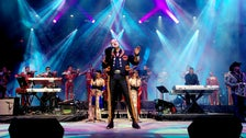 Pepe Aguilar singing on stage