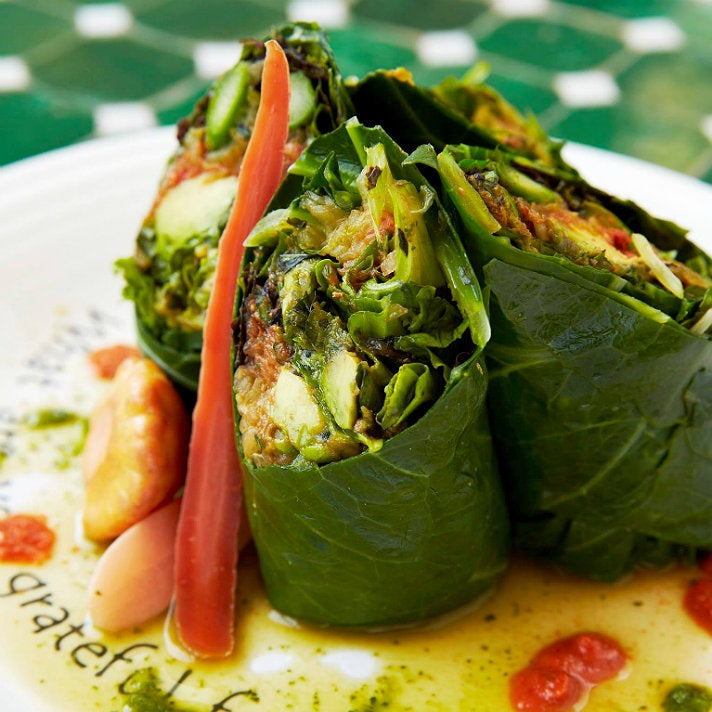 """Celebrating"" collard spring rolls at Cafe Gratitude"
