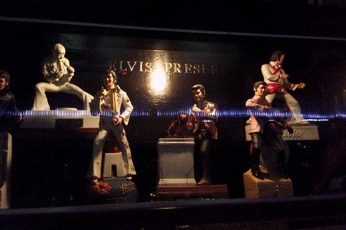 Elvis figurines in a glass case at the Formosa Café